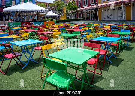 Multi coloured array of tables and chairs at an outdoor venue. Thailand Southeast Asia - Stock Image