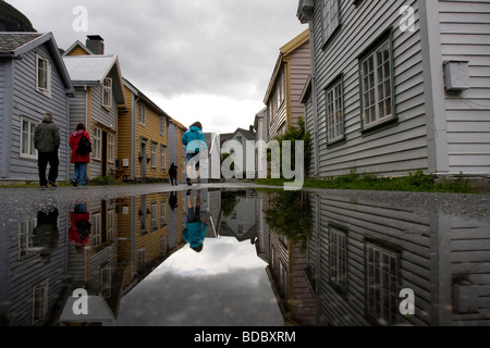 Old houses in the city of Laerdal reflected in a rain pool on the street, Laerdal, Sogn og Fjordane, Norway - Stock Image
