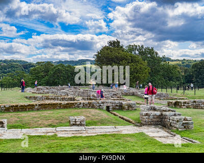 11 August 2018: Tourists viewing the excavated ruins of Chesters Roman Fort, Hadrian's Wall, Northumberland, UK - Stock Image