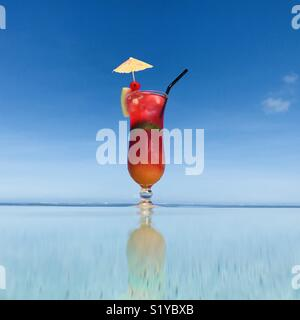 A tropical drink on the pools edge. Intercontinental Fiji Hotel, Natadola Beach, Fiji. - Stock Image