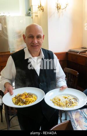 Italy Rome Restaurants dining  Server Nino at Yotvata a Jewish kosher restaurant in old Jewish section of Rome - Stock Image