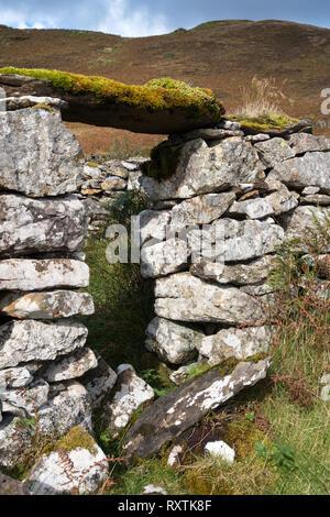 Doorway in ruins of old stone croft building, Boreraig, Isle of Skye, Scotland, UK - Stock Image