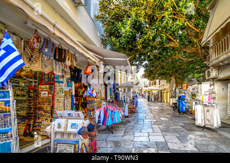 A typical tourist street and neighborhood in the Plaka District of Athens, Greece, with cafes, souvenirs and markets - Stock Image