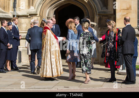 Windsor, UK. 21st April 2019. Princess Beatrice shakes the hand of the Dean of Windsor, the Rt Revd David Conner KCVO, as she arrives to attend the Easter Sunday Mattins service at St George's Chapel in Windsor Castle. Credit: Mark Kerrison/Alamy Live News - Stock Image