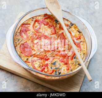 Homemade vegetable casserole au gratin with home grown tomatoes, mushrooms and cheese - Stock Image