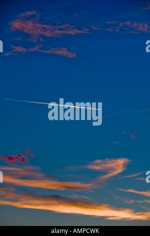 Jet aircraft trail on Blue sky in sunset time - Stock Image