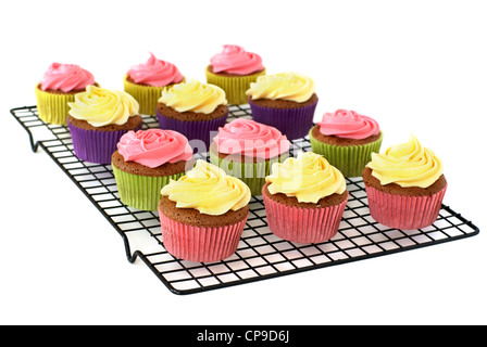 Chocolate cupcakes with vanilla frosting on a rack - Stock Image