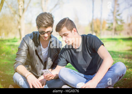 Friends receiving bad news - Stock Image
