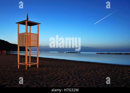 falling stars in san lorenzo' s night on the beach - Stock Image
