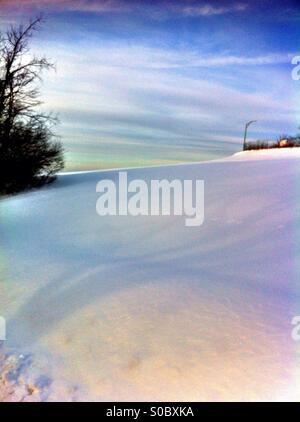 Snow covered hillside - Stock Image