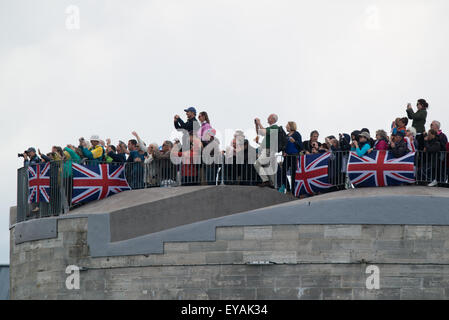 Portsmouth, UK. 25th July 2015. Spectators fill the Round Tower in Old Portsmouth with Union Flags attached to the - Stock Image