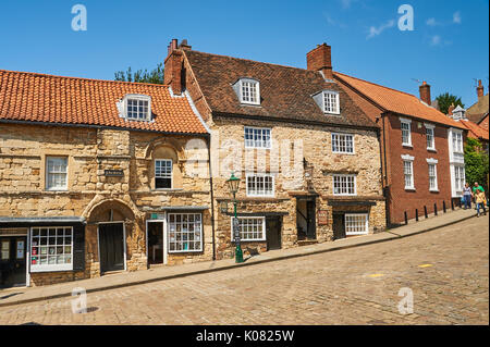 Steep Hill in Lincoln links the Cathedral with the city centre and is lined by a variety of building styles and purposes - Stock Image