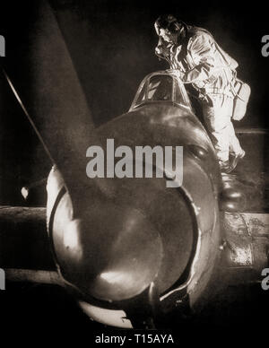 Pilot climbing into a  Hawker Hurricane fitted out as a night fighter. Following the Battle of Britain the Hurricane continued to give service as the principal single-seat night fighter in Fighter Command during the Blitz of 1941. - Stock Image