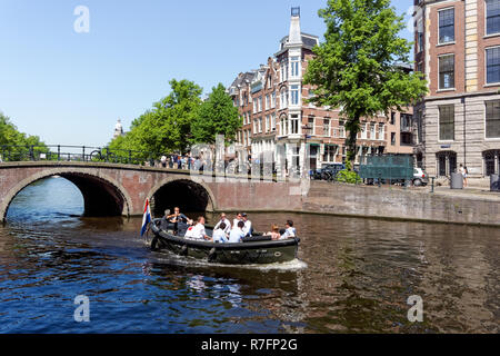 Boat on the Keizersgracht canal Amsterdam, Netherlands - Stock Image
