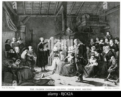 Inside a large wooden building, the pilgrims hold their first meeting. Various men and women sit and listen, as two men stand in the centre, one holding a book and talking, conduct the first meeting after landing in the New World. - Stock Image