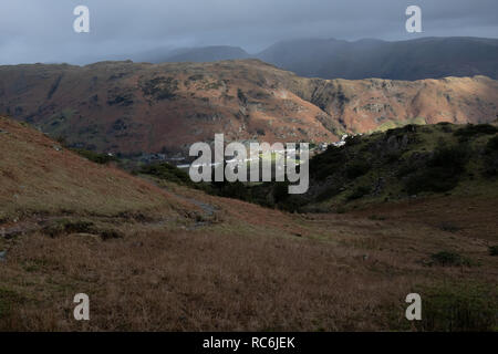 Chapel Stile, Cumbria, UK. 14th January 2019. UK weather. Sunlight illuminates the village of Chapel Stile in Cumbria. A warm bright day is expected to be followed by colder weather at the end of the week. Credit: Mark Hunter/Alamy Live News - Stock Image