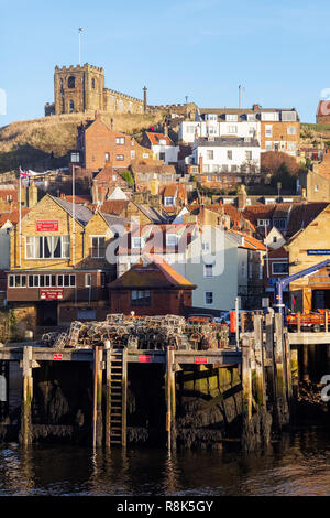 Winter sunlight on St Marys Church, the 'Old town quarter' and Fish pier, Whitby, North Yorkshire, UK - Stock Image