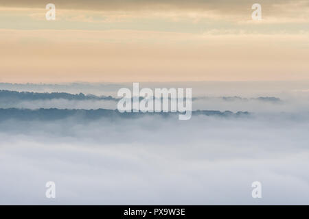 Wenlock Edge appearing through the mist, seen from Ragleth Hill, Church Stretton, Shropshire - Stock Image