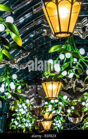 Decorative hanging Christmas lights in Covent Garden Market, London, UK - Stock Image