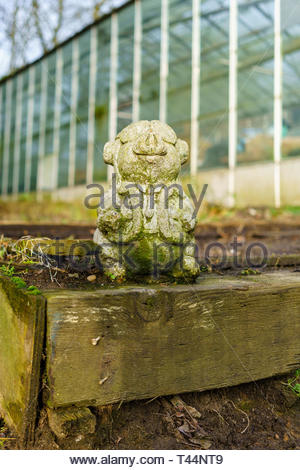 A pig ornament in a garden on a cold winter morning - Stock Image