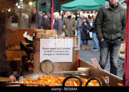 Allergy and food intolerance notice sign on a stall at Borough Market Christmas food in London England UK  KATHY DEWITT - Stock Image