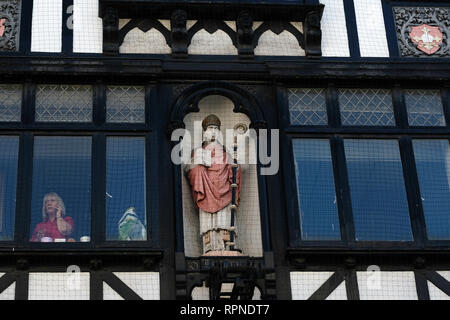 A woman working inside a Tudor revival building in Exeter, UK. - Stock Image