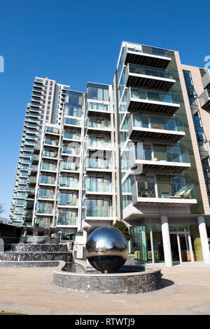 Modern flats or appartments, Berkeley Homes  with mirror ball waterfall sculpture to the fore, Woodberry Down, Stoke Newington Hackney London England  - Stock Image