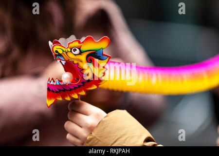 London, UK, 10 February, 2019. A man holding a dragon paper toy during Chinese New year celebration at China Town, SOHO, London, UK. Credit: Harishkumar Shah/Alamy live News - Stock Image