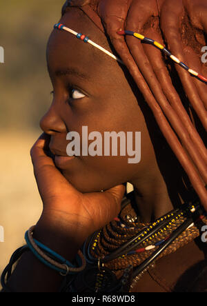 Himba tribe young woman, Cunene Province, Oncocua, Angola - Stock Image