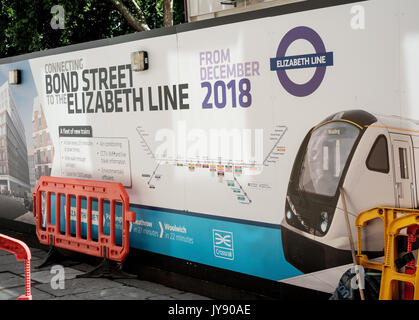 Hoardings around the Bond Street Crossrail station for the Queen Elizabeth underground line, due to open in 2018. London, UK - Stock Image