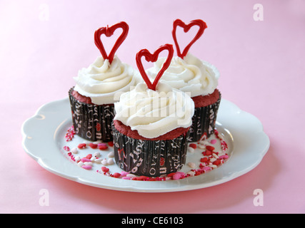 Red Velvet cupcakes with cream cheese frosting, decorated for Valentine's Day. - Stock Image