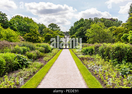 Gravel path and fountain at Nymans Gardens, Sussex UK - Stock Image