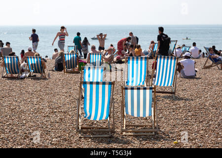 Deck chairs on the beach on Easter Sunday at Brighton in East Sussex, England. Record Easter temperatures were recorded in England in 2019. - Stock Image