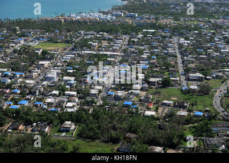 Blue, plastic tarps cover damaged roofs during relief efforts in the aftermath of Hurricane Maria November 6, 2017 - Stock Image