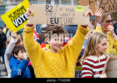 London, UK. 23rd Mar, 2019. Children are worried about their future. Remain supporters and protesters take part in a march to stop Brexit in Central London calling for a People's Vote. Credit: Vibrant Pictures/Alamy Live News - Stock Image
