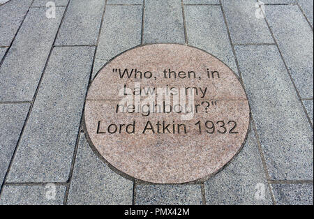 Quote by Lord Atkin on a pavement in Paisley, Scotland. The quote was used in a landmark court decision based on an incident that happened in Paisley - Stock Image