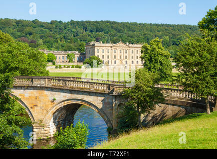 Chatsworth House park with an entrance bridge over the river Derwent parkland and woods Derbyshire England UK GB,  Europe - Stock Image