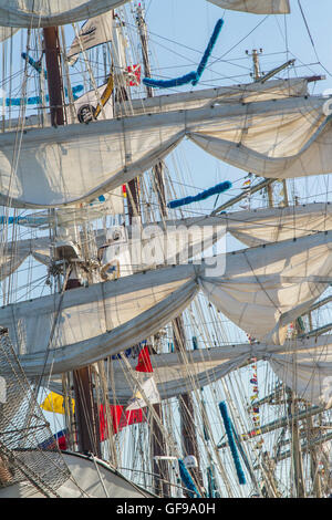 Sunlight catching the topsails of the Venezuelan tall ship 'Simon Bolivar' in the dock at Lisbon for the - Stock Image