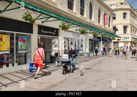 1 May 2018: Torquay, Devon, UK - Shopping in Fleet Street, on a warm spring day. - Stock Image