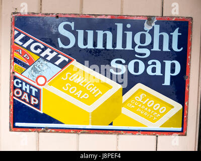 Old metal advertisement for SUNLIGHT SOAP in the UK - Stock Image