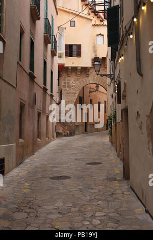 The old buildings in a narrow street in Palma de Mallorca, Spain. - Stock Image