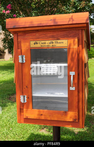 HICKORY, NC, USA-19 AUG. 2018:  A 'blessing box' in front of the local Elks Club stands empty. - Stock Image