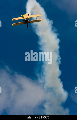 Inverted stunt flying with lot of smoke, Boeing N2S-5 Kaydet (E75) OE-AWW, Airshow Maribor 2008, Slovenia June 15, - Stock Image