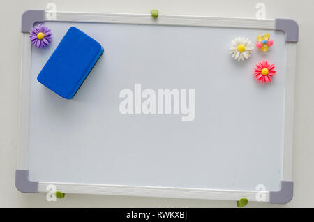 Small blank white board on wall. - Stock Image