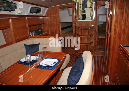 Wooden interior of the salon of a luxury saling yatch - Stock Image