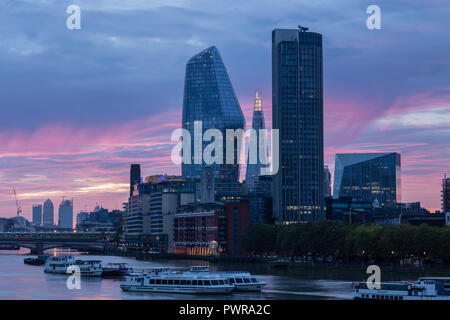 Sunrise over the river Thames at London from Waterloo bridge, with the shard, south bank tower, the vase, and the walkie talkie skyscrapers - Stock Image