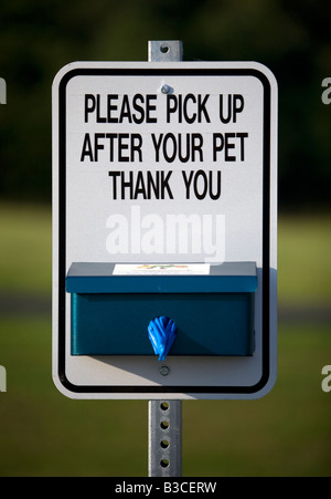 A sign asking park patrons to pick up after their pet in Bella Vista, Arkansas, U.S.A. - Stock Image