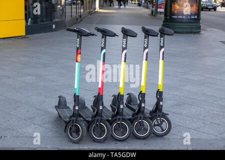 Colourful electric scooters by DOTT,  all lined up in the public spaces of Paris These scooters are the new means of transport voted in by the young g - Stock Image