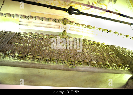 Lintel decorated with human remains in the Chapel of Bones, Church of St Francis, Evora, Alentejo, Portugal, Europe - Stock Image
