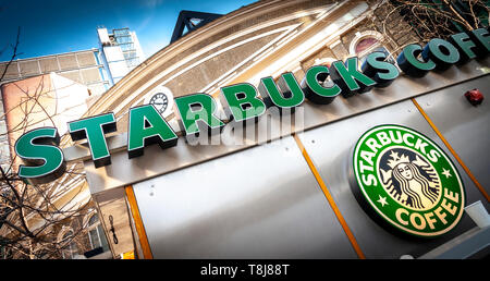 Starbucks Coffee Shop Sign, Starbucks is the largest coffeehouse company in the world, Founded in Washington, 1971. - Stock Image